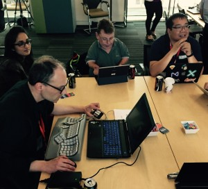 Hackers working around a table